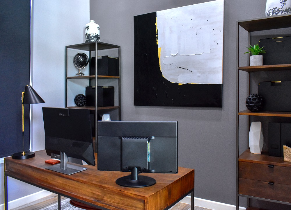 contemporary home office with large scale wall art diva by design harlingen interior designer