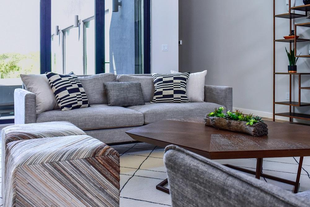 modern contemporary living room sofa with custom pillows diva by design harlingen interior designer