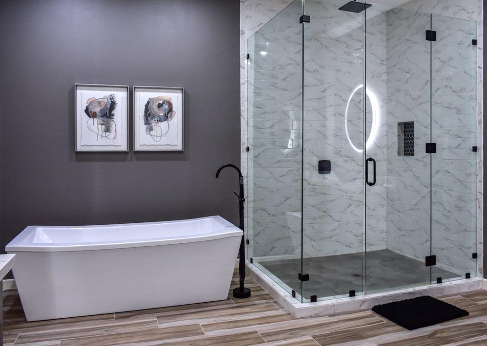 modern contemporary primary bathroom tub and shower diva by design harlingen interior designer