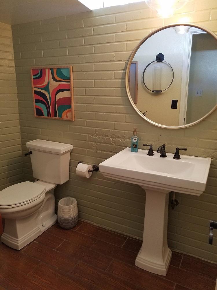 mcm powder room decor ideas diva by design harlingen interior designer